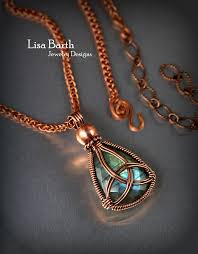 Designer Wire Jewelry Classic Triquetra Design Placed Within The Wire Wrap Around
