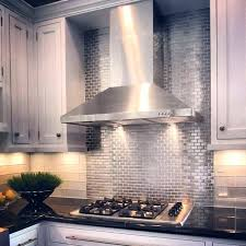 backsplash tile designs over stove black splash tile stainless steel tile behind stove then diffe subway tile surround black kitchen tiles