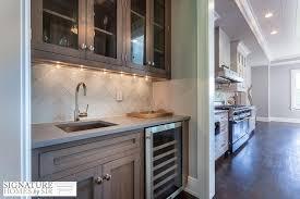 oak cabinets and white glass herringbone tiles view full size