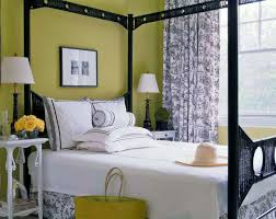 bedroom lime green bedroom showing green wall and twin white table lamps on bedside table