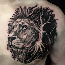 черная тату животные лев на торс спину голову руку