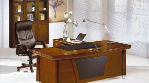 feng shui in the office. the office table shall not be placed between two walls or you will back corners which is harmful to your luck if conditions permit should face feng shui in