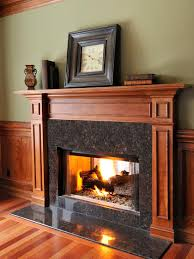 amazing fireplace decoration with white painted wooden mantle combined with black glossy glass mosaic fireplace surround and flat front hearth ideas
