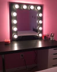 Black Makeup Vanity Surrounded With Lights And White Drawers Organizer  Storage