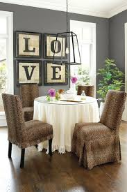 contemporary pendant lamp set above round dining table surrounded by brown leopard ikea dining chair covers