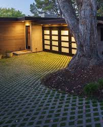 House With Brick Walls And Concrete Front Yard Driveway Designs Backyard Driveway Ideas