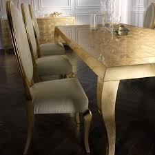 alligator effect leather chairs and gold leaf dining table set