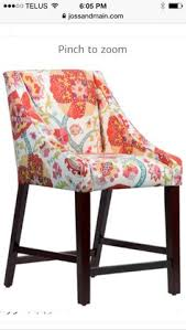 add a pop of color to your pub table or breakfast nook with this eye catching counter stool featuring a bold fl print and slope arms