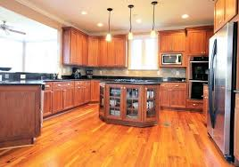 flooring for kitchen with oak cabinets the warm cabinets in this kitchen complement the wood flooring