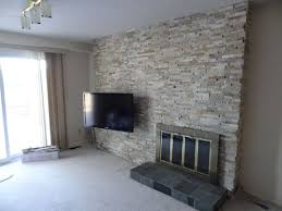 tv mount and stone fireplace surround ottawa case study ottawa s mymason rebuilds the wall reinforces the wall