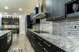 super white marble countertops with dark cabinets and tile backsplash