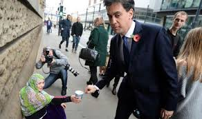 Ed Miliband accused of looking 'awkward' in picture of him giving ...