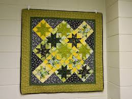 How To Hang a Quilt - Memory Quilts by Molly & If you wanted to hang a quilt on a cinder block wall, say in a dorm room,  Command Strips with a Spring clip work well. Adamdwight.com