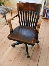old vintage wooden industrial or office desk armchair with casters antique wooden office chair
