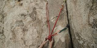 a climber setting anchor