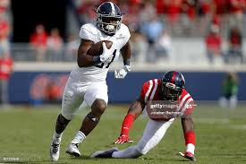 Wesley Fields of the Georgia Southern Eagles runs with the ball as... News  Photo - Getty Images