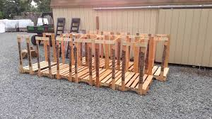diy outdoor firewood rack using reclaimed wood for small backyard spaces ideas