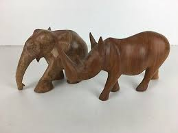 vintage rough carved wooden rhino elephant pair of animal figures