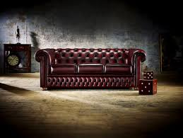 a chesterfield sofa has a very distinctive style that makes it stand out in any living room with rolled arms finely tacked studs and deep set oning