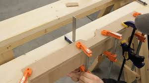 glue and clamps are used to join two pieces of mdf