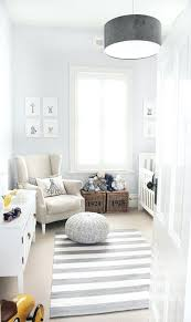 grey and blue nursery pale grey blue walls grey and white striped rug neutral accessories white grey and blue nursery