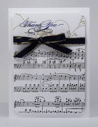 music note stamp final thank you card with a musical theme gold ribbons scores and