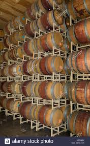 stacked oak barrels. Agriculture - Oak Wine Barrels Stacked Up In The Barrel Room Of A Winery / Lodi, California, USA. L