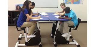 kids at classroom table. the kidsfit two-person pedal desk is designed to improve attention in kids at school. photograph courtesy of classroom table