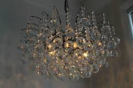 modern stainless steel chandelier hung with swarovski strass crystal this chandelier was originally purchased