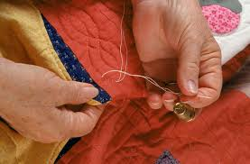 Use a Quilter's Knot to Secure Hand Quilting Stitches & Hand Quilting a Quilt Adamdwight.com