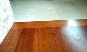vinyl plank flooring over tile should i do this you credit to laminate carpet transition on concrete installing floating ceramic