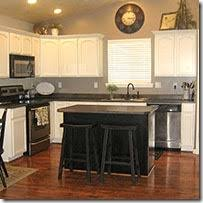 oak cabinets painted whiteRemodelaholic  Painting Oak Cabinets White and Gray
