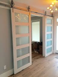 solid gl 4 paneled barn door by thewhiteshanty on etsy to go in between the living room and dining room