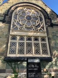 a stained glass window at the greenstone church in pullman ji suk yi sun times