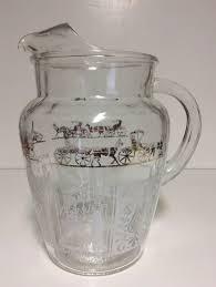 Vintage clear glass pitcher on pedestal