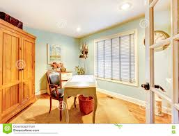 classic home office. Cozy Classic Home Office With Green Wall, Carpet And Small Empty Desk. Royalty-Free Stock Photo. Download
