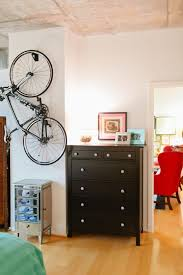 Bike hanger for apartment Space Saving Us Army Captain Katie Del Castillos Washington Dc Apartment Tour theeverygirl Apartment Bike Storage Pinterest Us Army Captain Katie Del Castillos Washington Dc Apartment Tour
