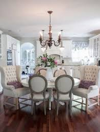 idea use only two wing chairs at a kitchen nook table for two