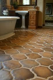 Multicolor brown terracotta floor tiles in a unique shape. #bathroom #tile  #CCC