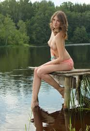Charming amateur naked girl on the lake 18 Photos TheFappening.