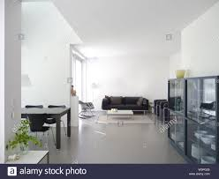 Design Your Own Dining Room Furniture Modern Private Living And Dining Room With Concrete Floor