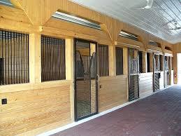 horse barn lighting aisle view custom stall fronts equine