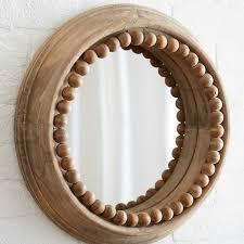 round wood frame mirror