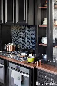 Image Marble Whirlpool Gold Gas Cooktop House Beautiful 10 Black Kitchen Cabinet Ideas Black Cabinetry And Cupboards