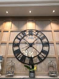 large black outline skeleton wall clock