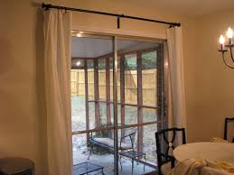 interior double white fabric curtains on black metal rod combined b sliding glass door with