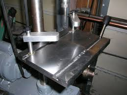 i m envisioning some way to quickly lock those hold down clamps this table btw is for tapping hence no hole for drilling