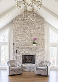 nothing makes as dramatic a statement as a fireplace surround that extends all the way to ceiling this is particularly true when the room the fireplace is