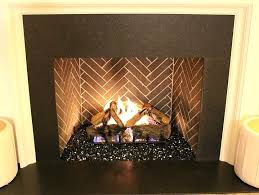 lava rock fireplace picture of black reflective fire glass covering lava rock fireplace lava rock fireplace