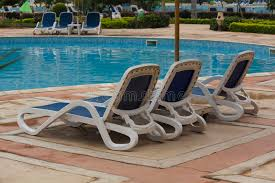 swimming pool lounge chairs stock photo image of grand concept 27923040